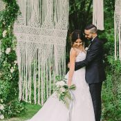 Macrame and Greenery Hanging Backdrop for a Bohemian Wedding Ceremony