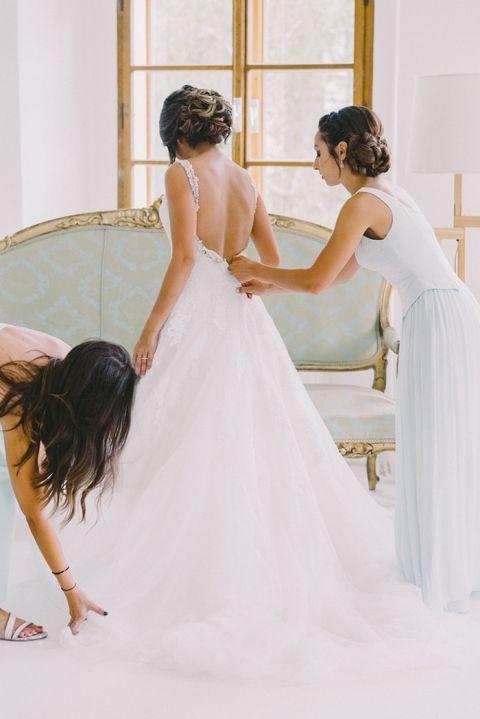 Bridesmaids Helping the Bride into her Princess Wedding Dress