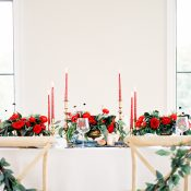 Winter Greenery Wedding Chair Accents with Red Flowers and Candles