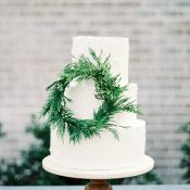White Cake with a Greenery Wreath For a Winter Wedding