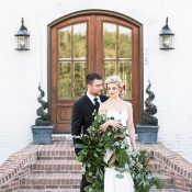 Bride and Groom with a Greenery Garland