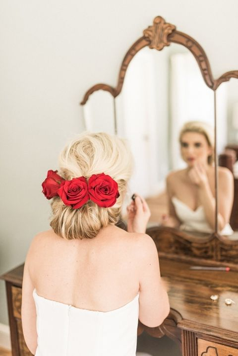 Elegant Chignon Hairstyle with Red Roses for a Winter Bride