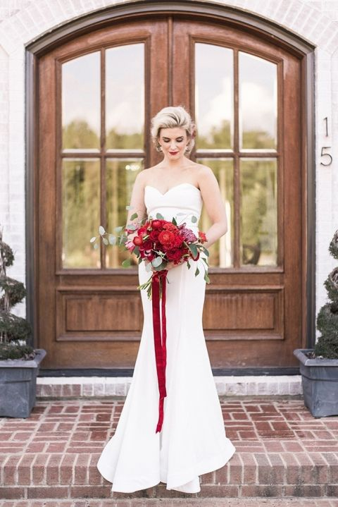 Warm winter wedding colors with timeless style hey wedding lady timeless winter bride with a red velvet bouquet junglespirit Choice Image