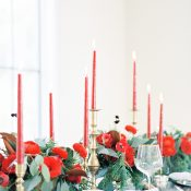 Red Candles and Flowers with Winter Greenery