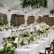Rustic Glam Tented Wedding Reception with Greenery Chandeliers