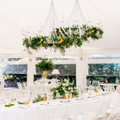 White and Orange Wedding Reception Decor with Greenery Chandeliers
