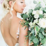 Open Back Lace Wedding Dress with a Greenery Bouquet