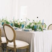 Natural Neutral Wedding Reception Decor with Pops of Blue and Greenery