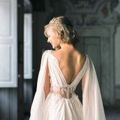 Glamorous Vintage Bride in a Sheer Lace Wedding Dress with a Chiffon Cape