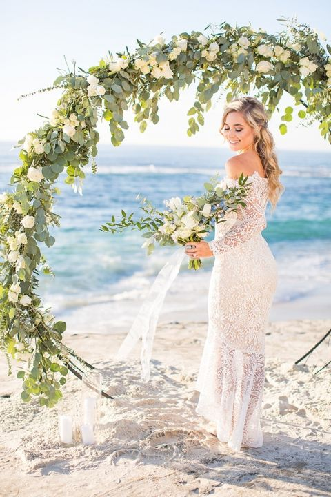 Greenery and Floral Arch for a Beach Wedding Ceremony