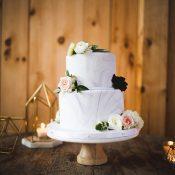 Modern Marbled Wedding Cake in Gray and Blush with Metallic Geometric Decor