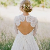 Open Back Lace Bridal Gown with a Floral Hairstyle
