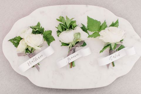 White Boutonnieres with Calligraphy Tags
