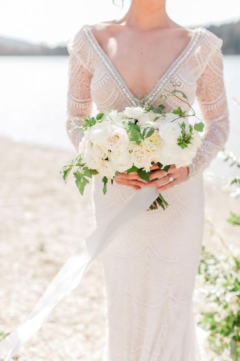 White and Greenery Bouquet with a Glam Long Sleeve Berta Wedding Dress