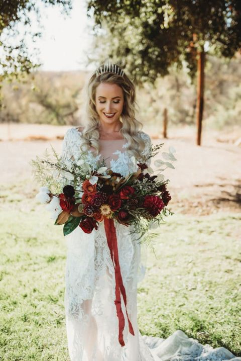 Boho Style for an Indie Bride with a Red Bouquet