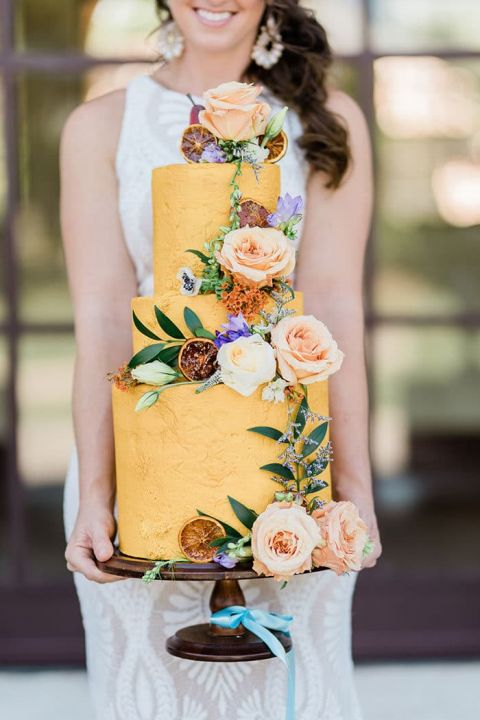 The Most Gorgeous Colorful Cake in Marigold Yellow with Fresh Flowers and Dried Fruit