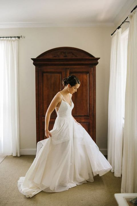 Bride Twirling in her Hayley Paige Wedding Dress