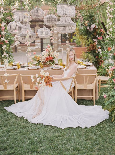 Coral Bali Wedding Style with a Bohemian Arbor and Hanging Wood Bead Lanterns