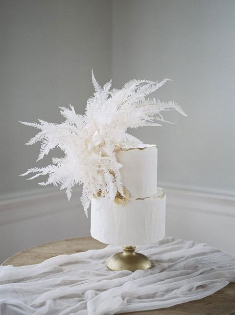 White and Gold Wedding Cake with a Bleached Fern Cake Topper