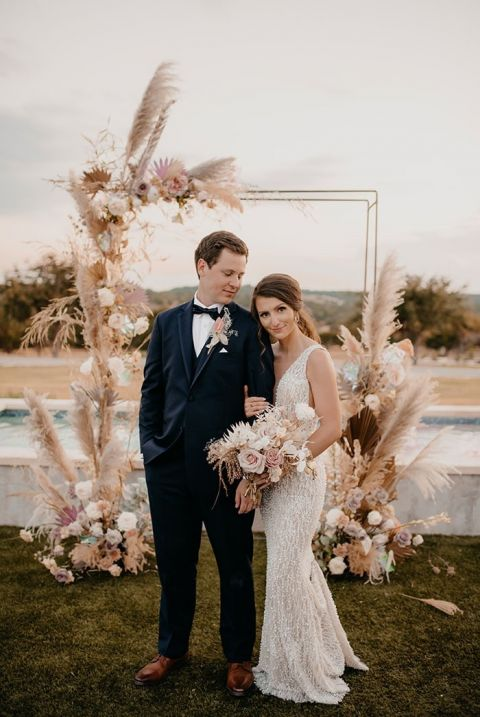 Epic Boho Wedding Ceremony Backdrop with Pampas Grass and Dried Flowers