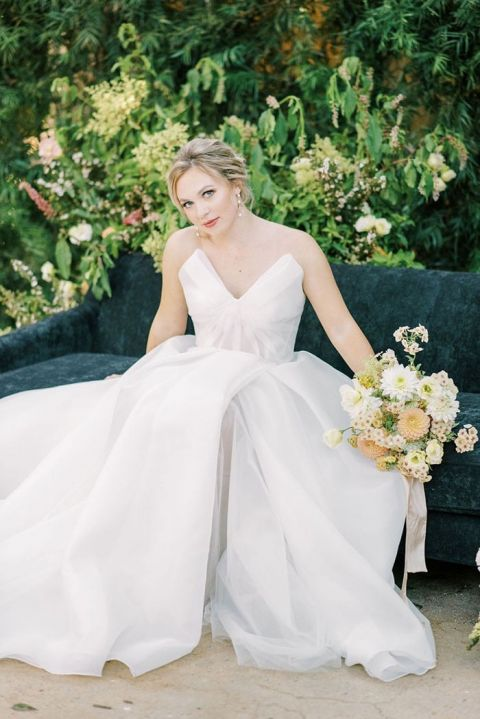 Structured Beccar Couture Wedding Dress on a Black Velvet Lounge