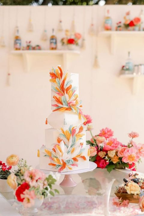 Colorful Work of Art Wedding Cake with a Feather Motif inspired by South American Textiles and Folk Art