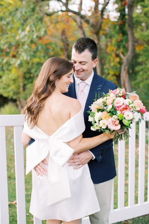 Bow Back Little White Dress with an Off the Shoulder Neckline for a Preppy Relaxed Backyard Ceremony