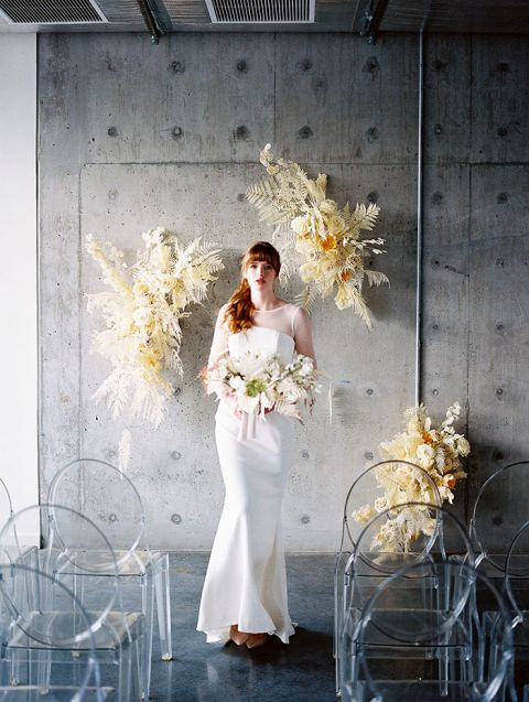Industrial Wedding Ceremony with Airy Dried Flower Installations and Pantone Colors of the Year Ultimate Gray and Illuminating for a Soft Glow