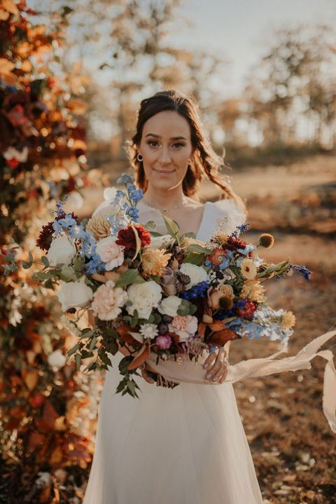 If Fresh Flowers aren't Your Thing, This Foraged Fall Wedding Arch is Ceremony Goals