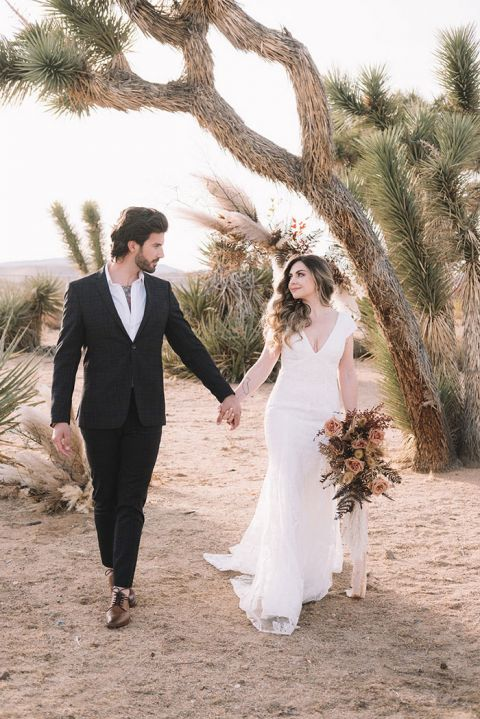 Magic Hour in Joshua Tree Wedding Photos with a Mix of Fresh Flowers and Dried Grasses