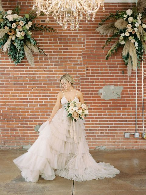 Romantic Industrial Style Blends a Ruffled Wedding Dress with a City Venue