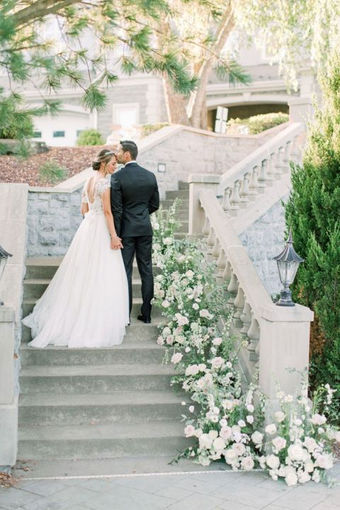 Ceremony Flowers transformed into a Staircase Decoration for this European Chateau Style Wedding